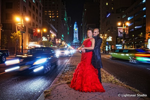 Just Married - Philadelphia weddings - Philadelphia multicultural weddings - Philadelphia fusion weddings- bride in a red dress - bride and groom on Broad Street