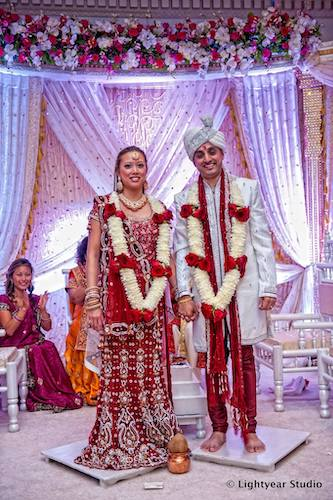 Indian fusion wedding - Indian Vietnamese wedding - Philadelphia multicultural weddings - bride and groom in traditional Indian wedding attire - traditional Indian wedding attire