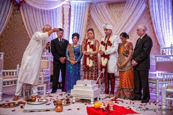 Vietnamese bride - Indian groom - Philadelphia multicultural weddings - Philadelphia fusion weddings - bride, groom and parents - Indian wedding ceremony