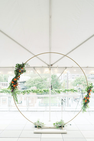 gold moon gate wedding arch decorated with purple and orange flowers at the Liberty View Ballroom