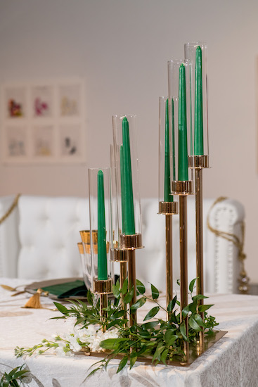 modern hunter green candles in a gold candelabra
